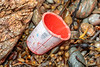 A yoghurt container of Spanish origin. This is a frequent litter item on the Guernsey sea shore.