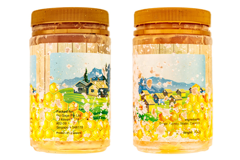 Honey jar from Singapore collected by Janet Unitt on the Guernsey's west coast sea shore