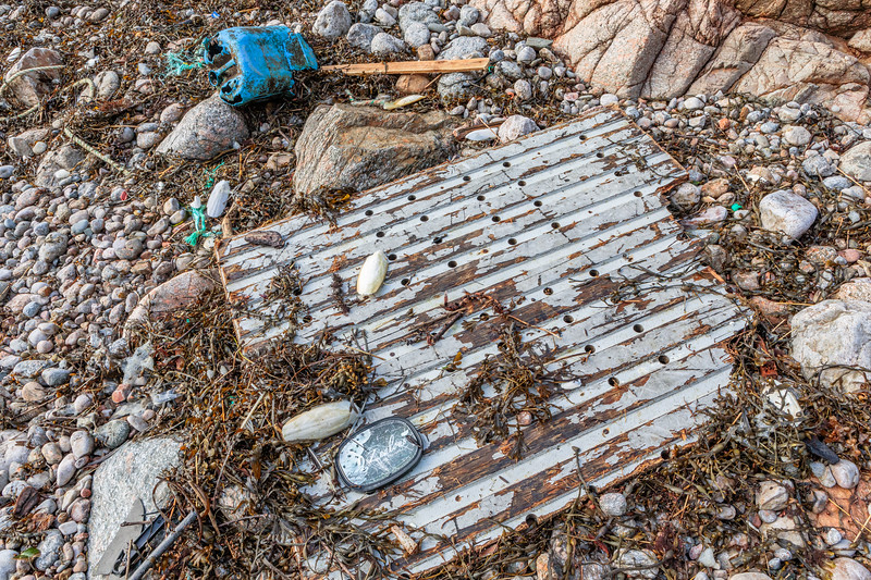 Wood floor plate and blue jerry can washed up at Petit Port on Guernsey's south coast on 17th February 2020