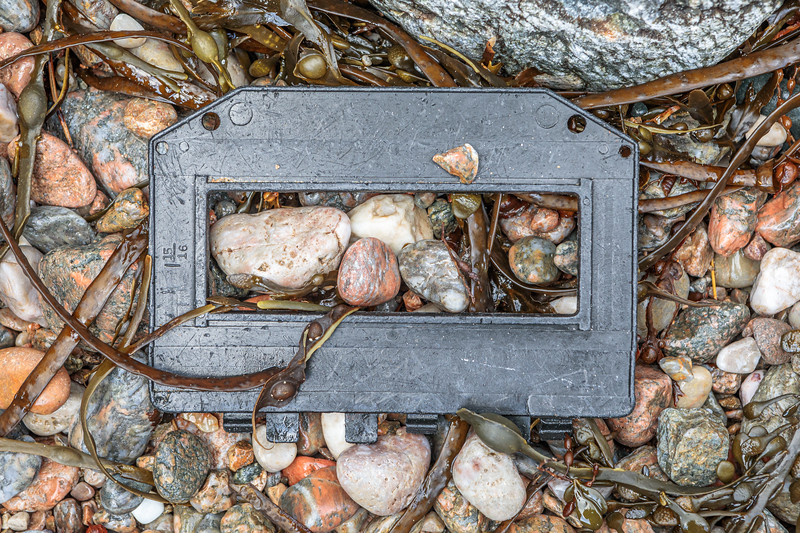Lobster trap plastic escape hatch with 1 15/16 inch opening washed up at Petit Port on Guernsey's south coast