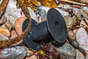 Black plastic reel made by Franz Filthaut GmbH washed up at Petit Port on Guernsey's south coast on 2nd February 2020