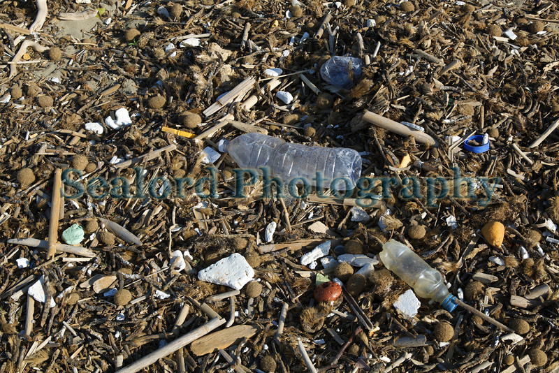 Plastic litter in the strand line of a beach by the city of Avola, Sicily, Italy on 2nd April 2010