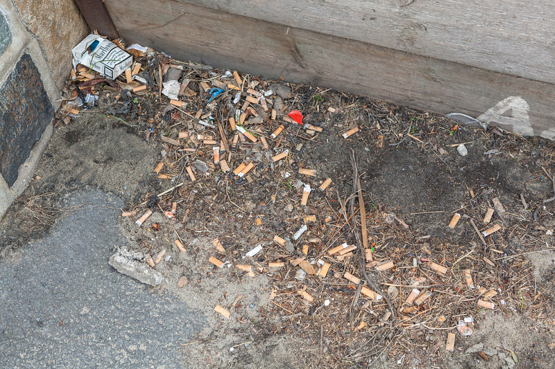 Cigarette litter by flood boards on Les Banques, St Peter Port, Guernsey on 12th May 2013