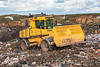 A Bomag refuse compactor goes over the rubbish deposited in the Mont Cuet landfill site on 24th November 2010