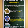 The Cooperative in Guernsey is making an effort to reduce the use of single use plastic carrier bags in their shops.  This sign at the Grande Marche supermarket in St Martin, Guernsey tells customers of some of the alternatives available.  Customers can still use plastic carrier bags free of charge but more and more customers are now bringing their own shopping bags to the supermarket.  Customers who bring and use their own reusable shopping bags are given one pence per bag to be donated to the Bourg Hospice in Guernsey.   The Guernsey Cooperative has seen plastic carrier bag use fall during the last year.  Guernsey Climate Action Network (G-CAN) has encouraged Guernsey supermarkets to stop giving out free plastic carrier bags to customers. <br /> File No. 1292<br /> fishinfo@guernsey.net