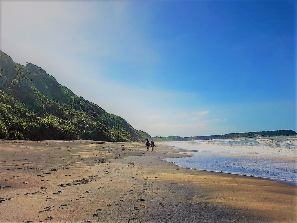 couple walking on a beach in Caraíva, Brazil