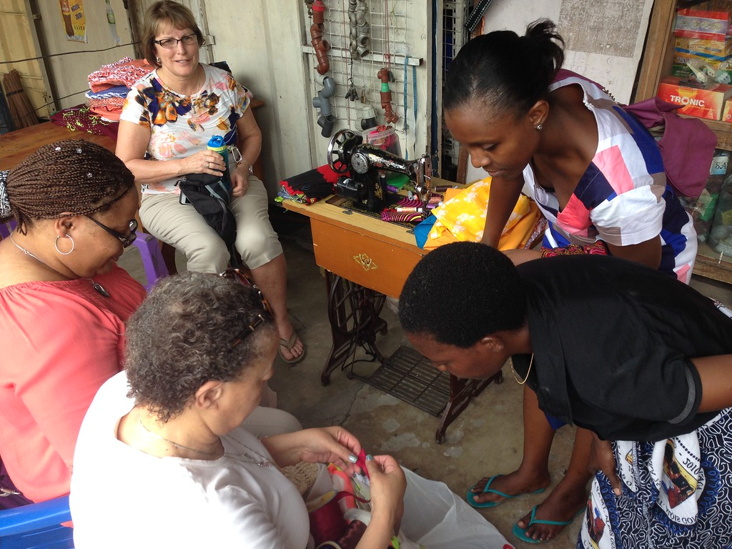 Sharing sewing techniques with InvesTours entrepreneurs on a GOOD _ Well Retreat to Tanzania