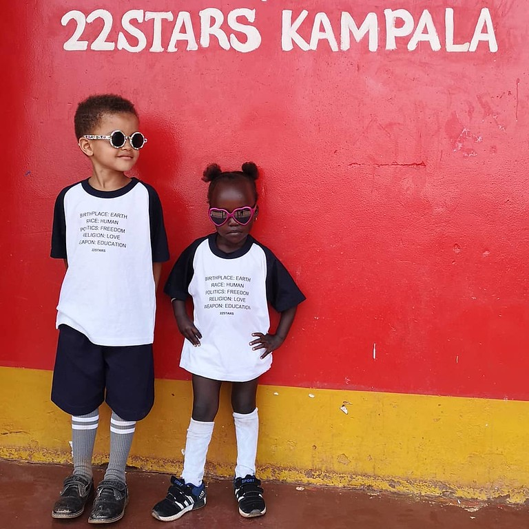 22Stars kids Rio and Tracy modeling their new t-shirts.