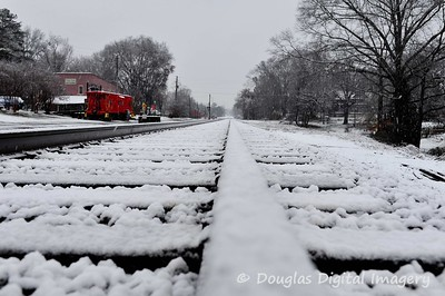 Looking down the railroad tracks in Old Town Suwanee in the Winter of 2009, non-cropped version.