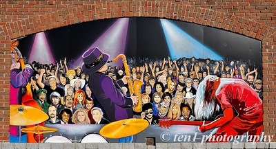 This is the mural of music greats from past and present on the back of the amphitheatre wall at Suwanee Town Center.