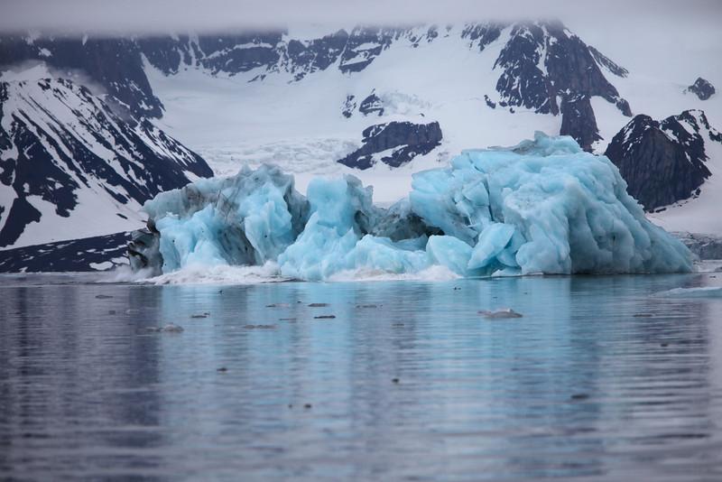 Blue iceberg breaking up in Hornsund