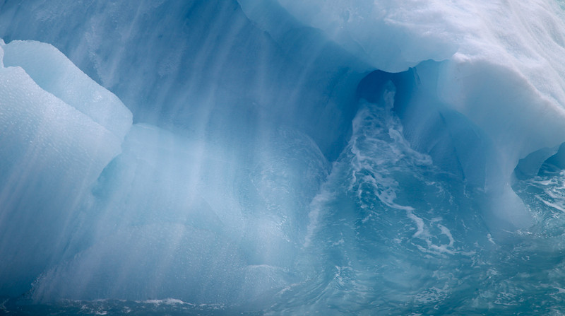An amazing blue iceberg in front of the Austfonna ice wall