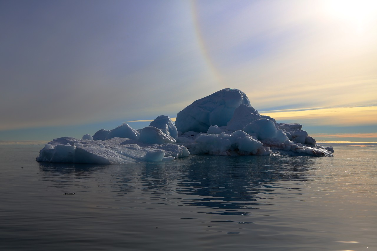 Sun bow and iceberg off Brasvellbreen