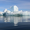 Zodiac and blue iceberg off Brasvellbreen