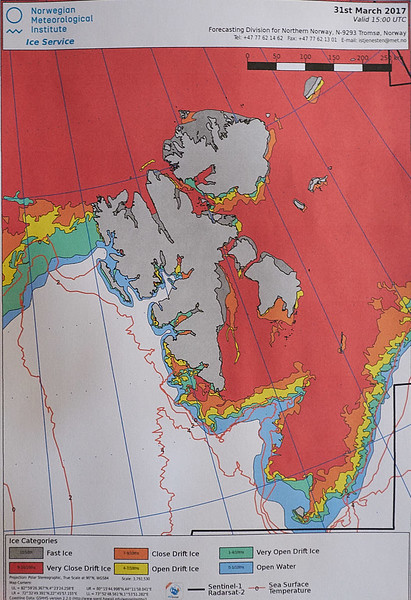 30.) This is a photo of the daily ice report from Norwegian Meteorological Institute. The colors dark gray, red and orange indicate ice conditions that we had to avoid. The Svalbard Islands are shown in light gray. These ice conditions and low temperatures were unusual for this time of year; usually the ice would have been a bit further North, vs hard against the islands on three sides.