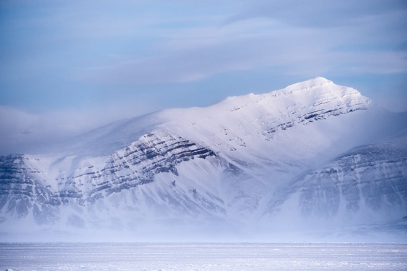 5.) Snow carried by the wind follows the contour of the mountain.