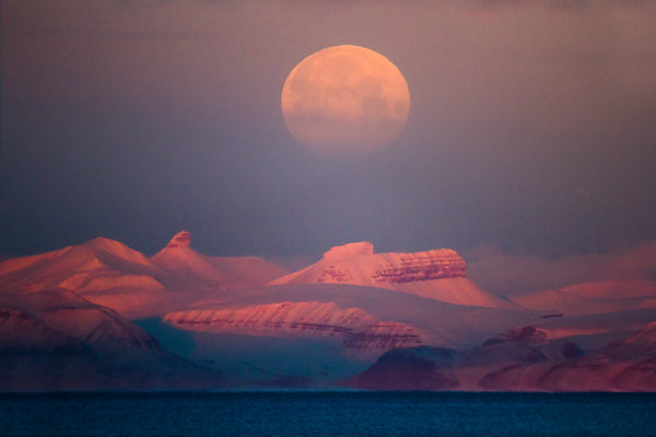 moon over spitsbergen mountains