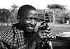 Massai boy with tripod