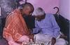Receiving Diksha Mantras from Shrila Gurudeva in the right ear