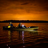 David Uhr and his son Austin Uhr, 16, participate in a moonlight kayak cruise around an island in Lake Fausse Pointe State Park near New Iberia, LA, Thursday, July 3, 2014. The Uhrs and fellow members Boy Scouts of America Troop 383 of Evansville, IN, completed the final leg of their sixty-mile kayak trek through the Atchafalaya Basin as part of the BSA Evangline Area Council's Swamp Base program on Friday, July 4. <br /> <br /> <br /> Photo by Paul Kieu, The Advertiser
