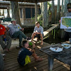 Derek Breaux, right, conducts the Connections to the Wetlands course on coastal conservation to Boy Scout Troop 383 of Evansville, Indiana, while participating in the Swamp Base program in the Atchafalaya River Basin near Henderson, LA, Tuesday, July 1, 2014. The program, held by the Evangeline Area Council, includes a 60-mile kayak trek through the Atchafalaya River Basin aimed to teach scouts about conservation efforts and Louisiana culture. <br /> <br /> Paul Kieu, The Advertiser