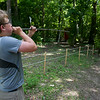 John Bizal, 16, shoots blow darts at a target while competing with fellow Boy Scout troop members on Island Outpost in Lake Fausse Pointe State Park near Loreauville, LA, Thursday, July 3, 2014. <br /> <br /> Paul Kieu, The Advertiser