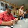 Christopher Everett, a troop leader and parent, creates a blow dart using a wooden skewer and polyester fiber on Island Outpost in Lake Fausse Pointe State Park near Loreauville, LA, Thursday, July 3, 2014. <br /> <br /> Paul Kieu, The Advertiser