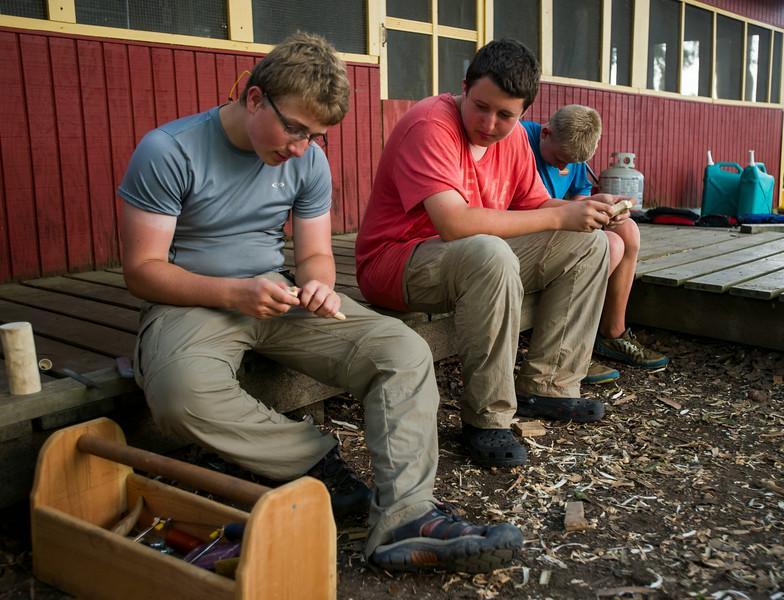 John Bizal and Garrett Erk, 16, carve wood on Island Outpost in Lake Fausse Pointe State Park near Loreauville, LA, Thursday, July 3, 2014. <br /> <br /> Paul Kieu, The Advertiser