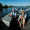 Keith Simon and Ben Pierce, the director of the Swamp Base program, ride in a motorboat to meet a group of Boy Scouts participating in the Swamp Base 60-mile kayak trek in the Atchafalaya River Basin near Henderson, LA, Tuesday, July 1, 2014. <br /> <br /> Paul Kieu, The Advertiser
