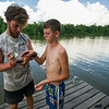 Trek guide Robert Donadieu assists a Scout with retrieving a small catfish caught using a yo-yo line on Island Outpost in Lake Fausse Pointe State Park near Loreauville, LA, Thursday, July 3, 2014. <br /> <br /> Paul Kieu, The Advertiser