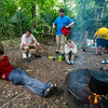 Boy Scouts of Troop 383 relax near a campfire built during a wilderness survival course on Rougarou Island in the Atchafalaya River Basin near Catahoula, LA, Tuesday, July 1, 2014. <br /> <br /> Paul Kieu, The Advertiser