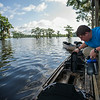 Members of Troop 383 prepare to depart for the houseboats for a short trip to Cypress Cove landing in the Atchafalaya River Basin near Henderson, LA, Tuesday, July 1, 2014. <br /> <br /> Paul Kieu, The Advertiser