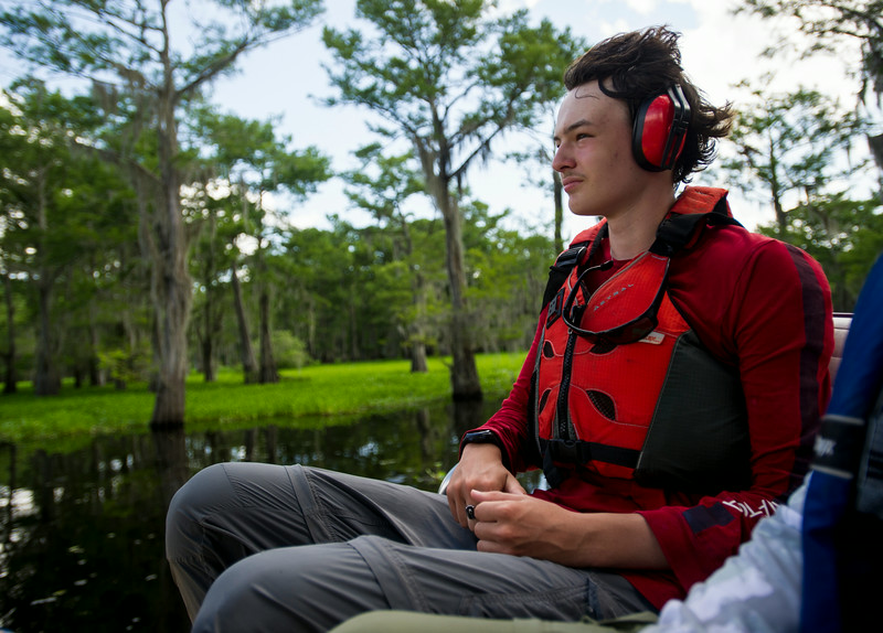 Austin Uhr, 16, rides on an airboat during a tour of swampy area in the Atchafalaya River Basin near Henderson, LA, Tuesday, July 1, 2014. Uhr and his Boy Scouts of America Troop 383 of Evansville, Indiana, completed a 60-mile kayak trek as part of the BSA Swamp Base program conducted by the Evangeline Area Council. <br /> <br /> Paul Kieu, The Advertiser