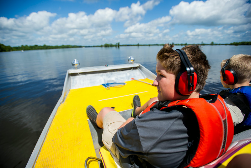 Martin Everett, 13, rides on an airboat during a tour of swampy area in the Atchafalaya River Basin near Henderson, LA, Tuesday, July 1, 2014. Everett and his Boy Scouts of America Troop 383 of Evansville, Indiana, completed a 60-mile kayak trek as part of the BSA Swamp Base program conducted by the Evangeline Area Council. <br /> <br /> Paul Kieu, The Advertiser