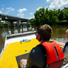 Members of Boy Scout Troop 383 of Evansville, Indiana, approach the Atchafalaya Basin Bridge while riding in an airboat in the basin near Henderson, LA, Tuesday, July 1, 2014. The troop is currently participating in the Evangline Area Council's Swamp Base kayak trek which takes them on a sixty-mile path through the basin. <br /> <br /> <br /> Photo by Paul Kieu, The Advertiser