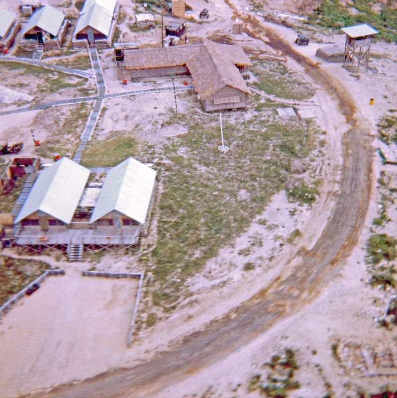 LCS-59: Looking east to west as you approach one of the landing zones on Cherry Hill.  He thatch covered building in the top of the photo is the officers club, which had very cheap drinks.