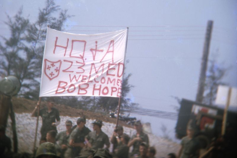 LCS-33: The 23Med sign at the 1967 Bob Hope Christmas show in Chu Lai.  Wounded soldiers that could make the ride to the show were given good seats.