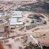 LCS-52: This photo is an aerial photo of a portion of Cherry Hill, which was behind the rock quarry across the highway from Chu Lai. At the very top of the photo and slightly to the left of center you can see the end of a small white building with blue trim. This building was Mau's Store and was immediatly above the 1/14th Arty Radar Site at Chu Lai. The dark blot just to the left of it is our Q4 countermortar/rocket radar. Moving to the left and still at the very top you cross a road and then see a small tent at the beginning of a row of hootches. The tent was where Al Simms lived as the radar mechanic of the 1/14th Arty radar. The rest of the hootches were HSB for 3/18th Artillery. Below the store and slightly to the right is LZ Hurricane which was one of 3 LZs on Cherry Hill. The buldings in the center and left of the photo were all part of the 3/18th Artillery HHB area.  Thanks to Al Simms, 1/14th Arty. for the update on this photo