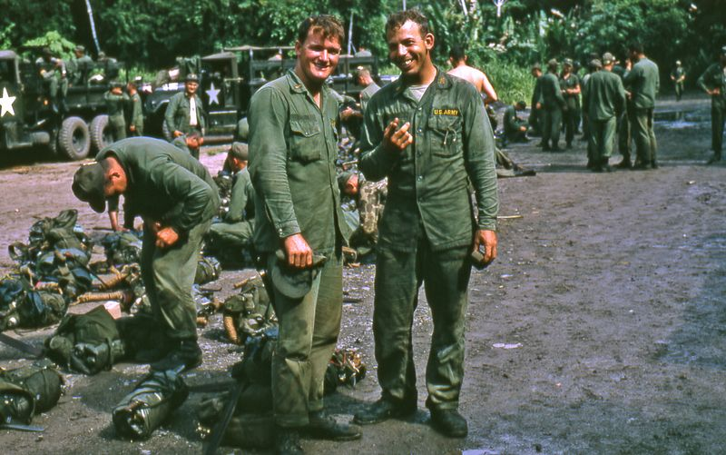 """LCS-10: Larry Swank (center) standing next to Richard """"Dick"""" Scibelli (pointing at camera) at Jungle School in Panama.  This two week course cut two weeks off your year in Vietnam - that didn't happen. Dick and Larry were in the same Artillery OCS class.  Dick served in Vietnam in 67-69 and was assigned to Division Artillery at the Americal Division."""