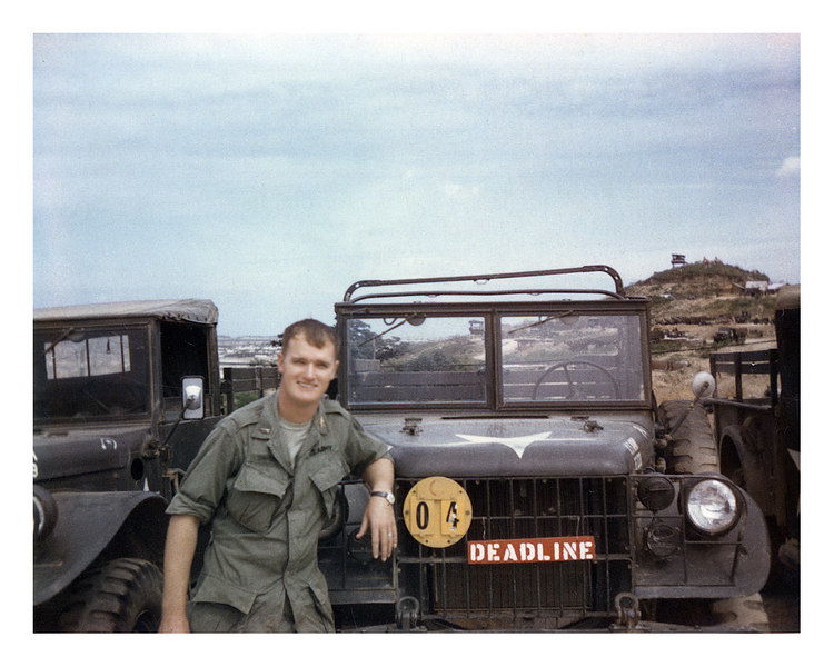 LCS-75: Larry Swank on the job as Maintenance Officer for the HQ motor pool with the 3/18th Artillery at Charry Hill, just outside of the gate to the Chu Lai airfield.