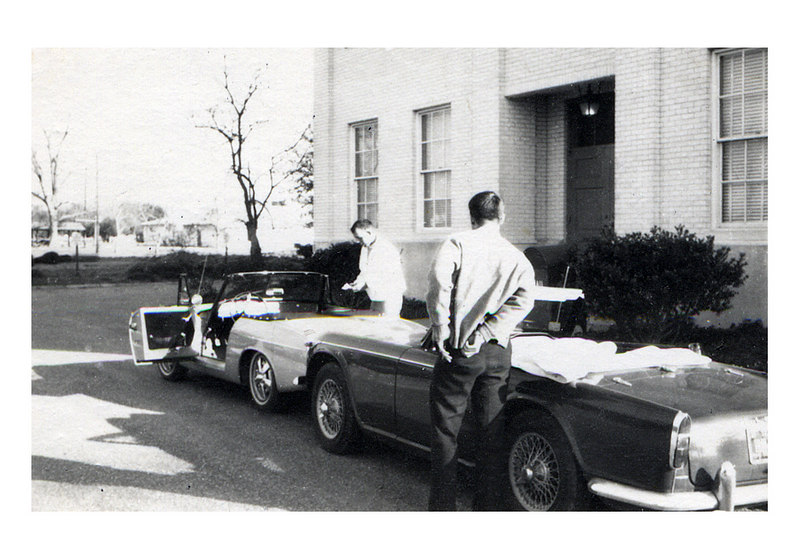 "LCS-68: Richard ""Dick"" Scibelli next to his 67 Datsun Sports Roadster and Larry Swank with his 67 Triumph TR4-A departing Ft Polk, LA for Jungle School in Panama - or just leaving Ft Polk for a weekend road race."