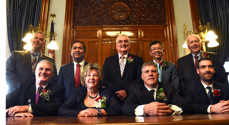 Newly elected and sworn In Lowell City Councilors L-R, front row, Rodney M. Elliott, Rita M. Mercier(Vice Mayor), John J. Leahy (Mayor), John Drinkwater, back row, Daniel P. Rourke, Sokhary Chau, David J. Conway, Vesna Nuon and William Bill Samaras. SUN/ David H. Brow