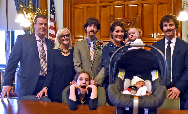 Newly elected Lowell School Committee Member, Michael Dillon Jr., with his famly, L-R, Michael Dillon Sr., Cathie Dillon(his mother and father), Michael Dillon Jr., Allison Dillon(his wife) holding Farrah Dillon 1 yearold, and Kevin Dillon (Michael's brother), in front is Keelyn Grady 11 years old(step daughter) and his latest addition Rynne Dillon only 5 days old. SUN/ David H. Brow