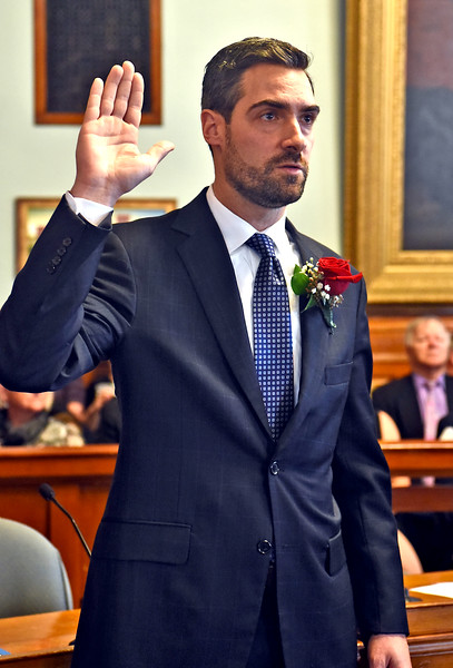 Being sworn In as a new Lowell City Councilor is John Drinkwater. SUN/ David H. Brow