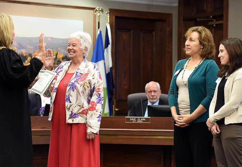 "Kathi Wright, left, Loveland's new ward 2 city councilor, is sworn in by Judge Geri Joneson, far left, as her ""Boys and Girls Club family"" Tammy Chandler, right, and Kaycee Headrick, far right, watch Tuesday, Nov. 14, 2017, at the municipal building in downtown Loveland.  (Photo by Jenny Sparks/Loveland Reporter-Herald)"