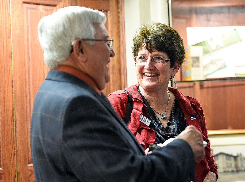Loveland's outgoing Mayor Cecil Gutierrez, left, and incoming Mayor Jacki Marsh, right, chat during a reception before Marsh and coucilors are sworn in Tuesday, Nov. 14, 2017, at the municipal building in downtown Loveland. (Photo by Jenny Sparks/Loveland Reporter-Herald)