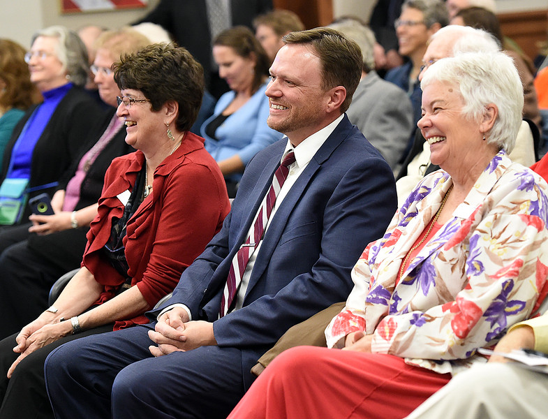 Jacki Marsh, left, Loveland's new mayor, and new city councilors Jeremy Jersvig, center, and Kathi Wright, right, all smile as they prepare to be sworn in Tuesday, Nov. 14, 2017, at the municipal building in downtown Loveland. (Photo by Jenny Sparks/Loveland Reporter-Herald)