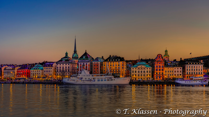 The Gamla Stan waterfront skyline at night in Stockholm, Sweden.