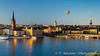 The city skyline with a hotair balloon at sunset in Stockholm, Sweden.