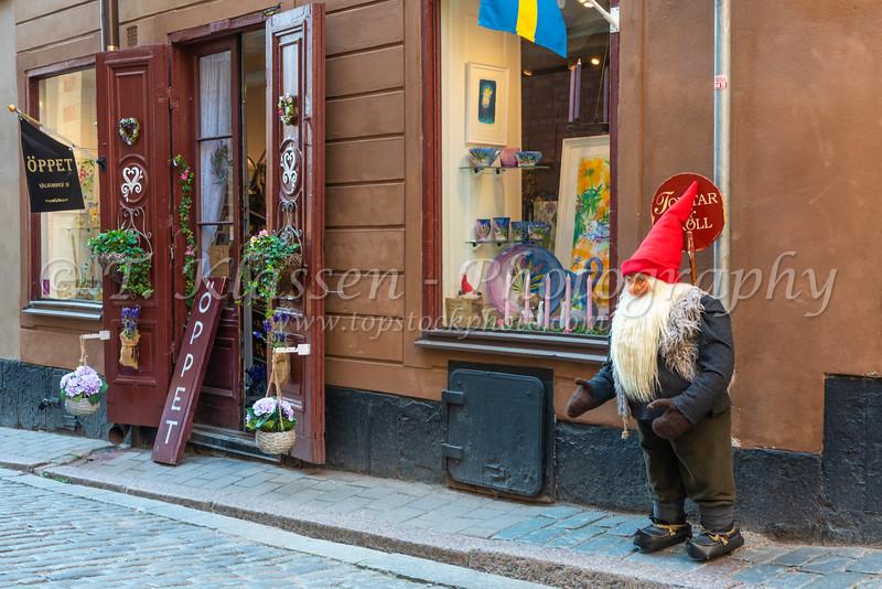 Shops,stores and outdoor restaurants in old town Gamla Stan in Stockholm, Sweden.